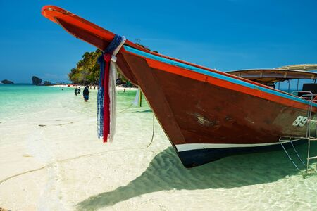 Wooden boat on crystal andaman sea at Thale waek island with white sand, blue sky, Krabi, Thaiand. Famous tourist travel destination in summer of Southern Thai.