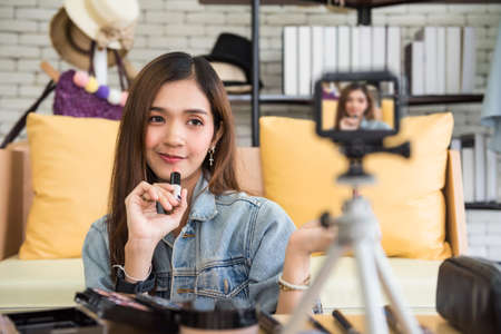 live streaming video camera of Beauty blogger woman lipstick makeup. internet influencer or vlogger recording daily make-up routine tutorial for online content.