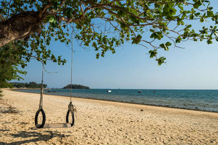 Beautiful nature scenic landscape of swing and beach in summer at Klong Muang Beach, Krabi, Thailand, Krabi, Thailand. Travel tourism destination place Asia. 免版税图像