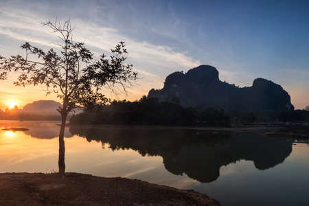 Lake and Karst mountains with mist at sunrise in Nong Thale, Krabi, Thailand. Famous travel destination in Thai southern at winter. Reklamní fotografie
