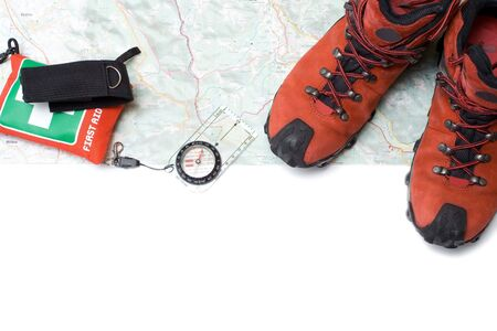 Hiking shoes and equipment on map with compass(clipping path) Stock Photo - 6676719