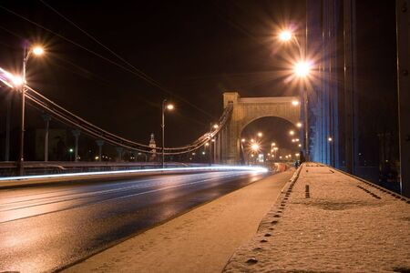 Suspension bridge at night in Wroclaw, Poland photo
