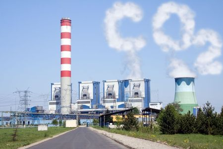 Power plant with chimney and cooling towers with CO2 clouds photo