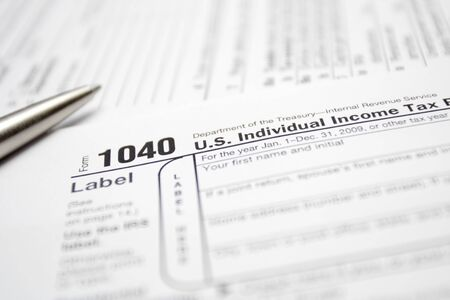 1040 Tax Return Form and silver pen closeup. Stock Photo - 7037167