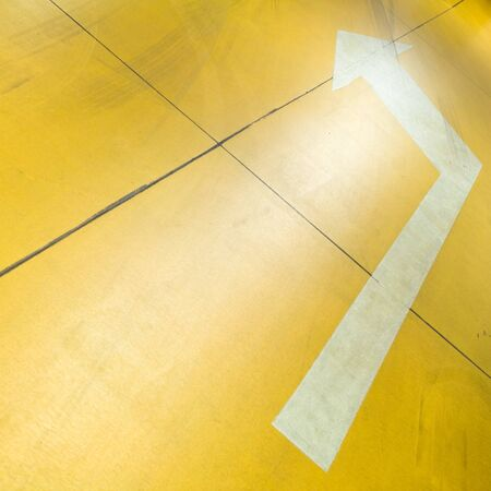 Underground parking garage with white arrow on yellow floor Stock Photo - 7031173