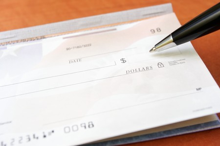 check blank: Blank check, checkbook and pen as a financial concept