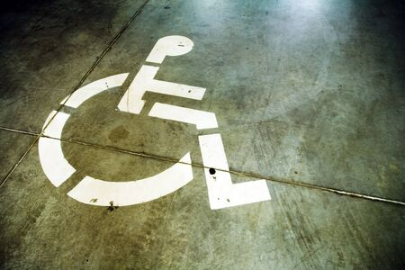 Underground garage floor with disabled sign on parking place Stock Photo - 7037465