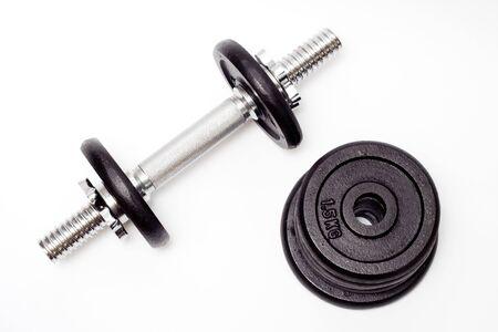 Black dumbbell, bodybuilding equipment isolated on white background. Fitness concept Stock Photo - 7037338