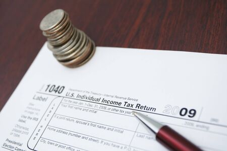 1040 tax form, pen and coin as a financial concept Stock Photo - 7037211