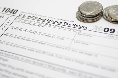 1040 tax form and coins Stock Photo - 7037163