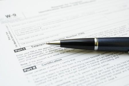 podatnika: Przeznaczone do walki W9 podatku formularza radioelektronicznej z fokusem na podatnika Zdjęcie Seryjne