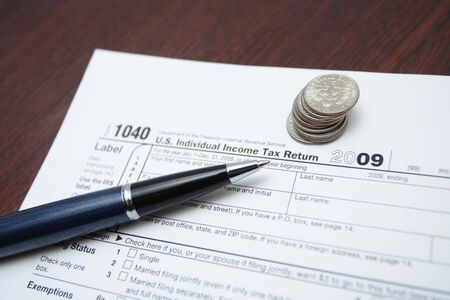 1040 tax form, pen and coins as a finance concept Stock Photo - 7037238