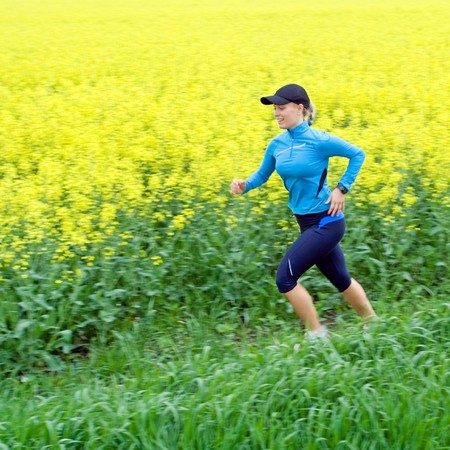 Woman runner running outdoors in spring, motion blur. Stock Photo - 7031174