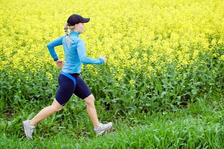 spring training: Woman runner running outdoors in spring, motion blur Stock Photo