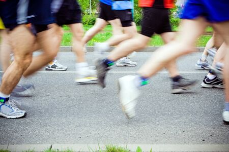 Motion blur of people running in city marathon Stock Photo - 7037398