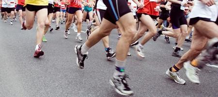 Runners running in marathon race in city