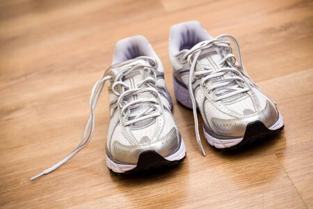 Running shoes after workout at gym.Shallow depth of field with focus on front of the shoes. Stock Photo - 7037240