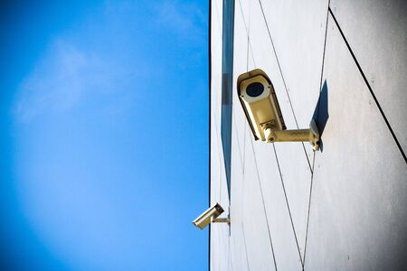 Security camera on building and blue sky