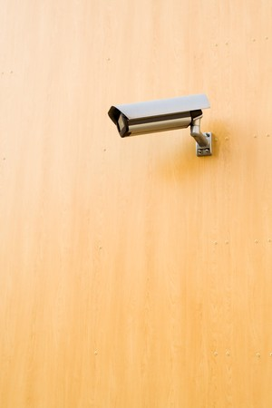 Modern brown building with security camera Stock Photo - 7037213