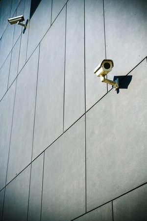Dark building with security cameras looking around photo