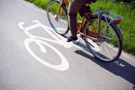 Blurred cyclist riding bicycle on a bike path in Wroclaw Poland. photo