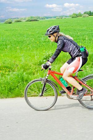 Woman ride mountain bike, motion blur. photo