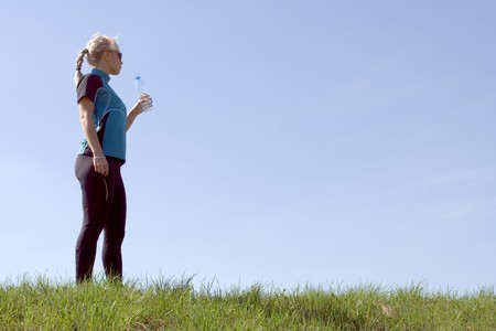 Silhouette of woman drinking water after running outdoors Stock Photo - 7037251