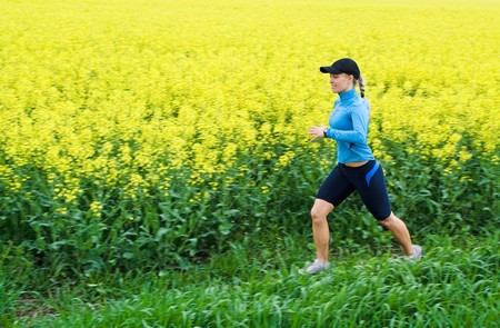 Woman runner running outdoors in spring, motion blur Stock Photo - 7037458