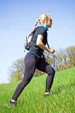 spring training: Woman on power walking workout outdoors Stock Photo