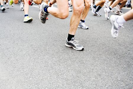 Runners running in marathon race in city Stock Photo