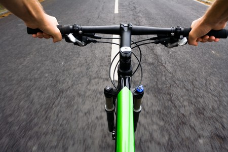 Bicycle rider riding real fast, motion blur photo