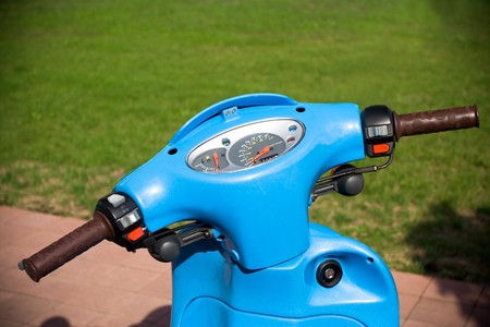 Blue scooter on parking lot photo