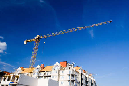 Construction site over summer blue sky, building growth photo