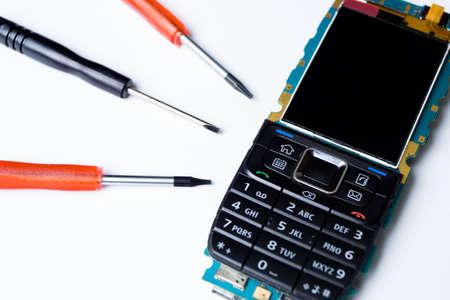 Mobile phone and repair tools Stock Photo - 7712165