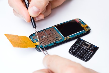 Mobile phone repair by technician photo