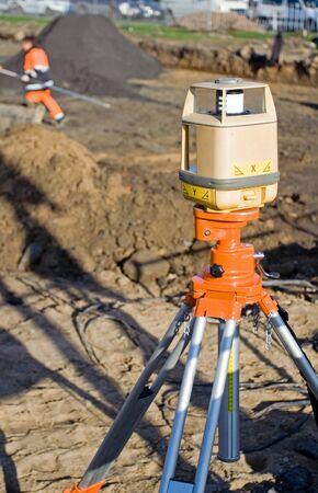 geodesist: Geodesists theodolite on road construction site