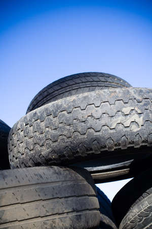 Tire recycling, heap of old tires photo