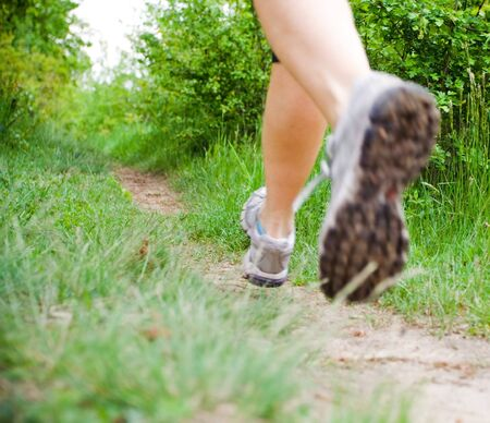 trail running: Woman running in forest, cross country fitness, motion blur