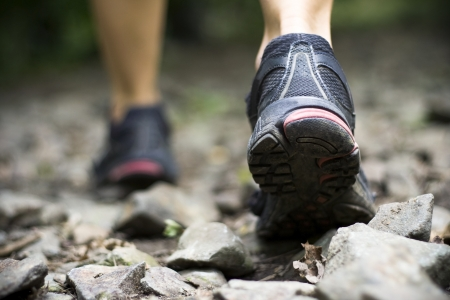 cross walk: Sport shoes on trail walking in mountains Stock Photo