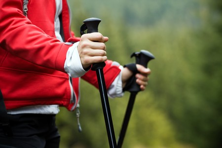 scandinavian people: Nordic Walking in Autumn mountains