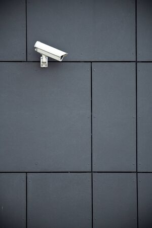 electronic security: Security camera on dark modern building Stock Photo