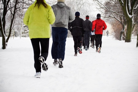 People running in park on snowy winter, motion blur photo