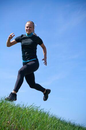 Woman training cross country running  photo