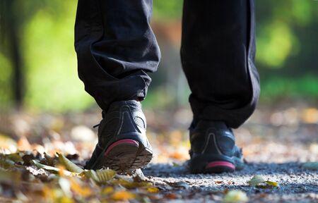 Exercising legs in autum park photo