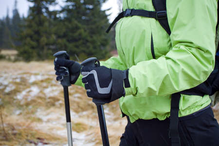 Woman on nordic walking trip in winter mountains photo
