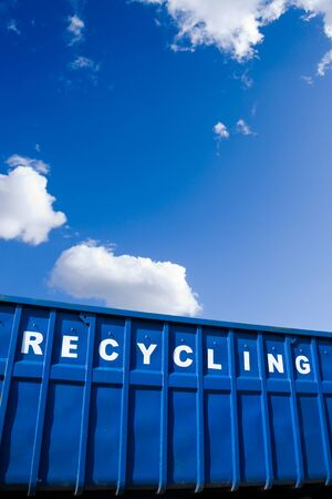 blue bin: Recycling container over blue sky Stock Photo