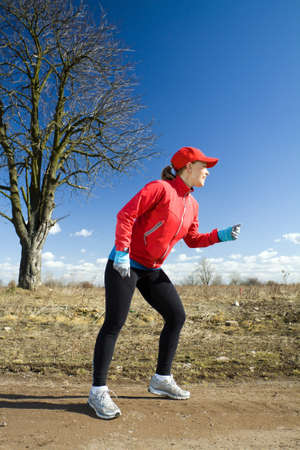 power walking: Running on early spring. Healthy lifestyle concept. Stock Photo