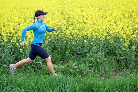 Woman runner running on green field , exercise outdoors Stock Photo - 9755663