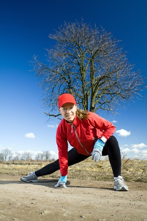 Early spring exercising on dirt country road. Healthy lifestyle concept. Stock Photo - 9305929