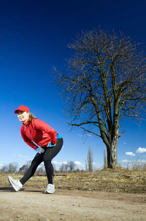 Early spring exercising on dirt country road. Healthy lifestyle concept. photo